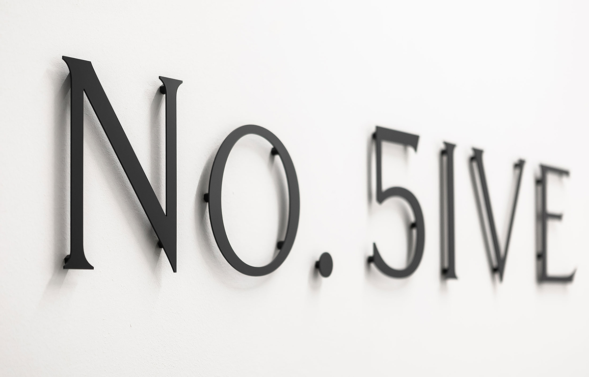 Bespoke internal metal signage for No. Five, serviced offices in Blackheath Village, South East London.
