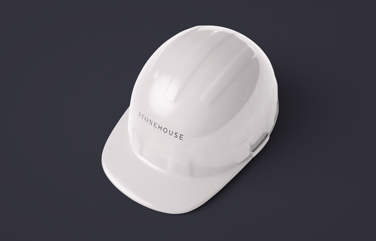 Branded hard hat design, part of our visual identity for Stonehouse, a building contractor based in Devon, South West England.